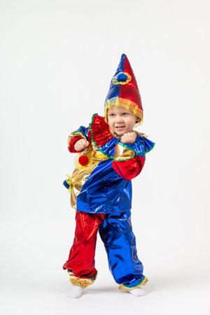Child kid boy preschooler in Harlequin, Arlecchino, Arlequin, costume dancing. Vertical shot isolate on white background. Concept of theater, performances, kindergartens. Stock fotó