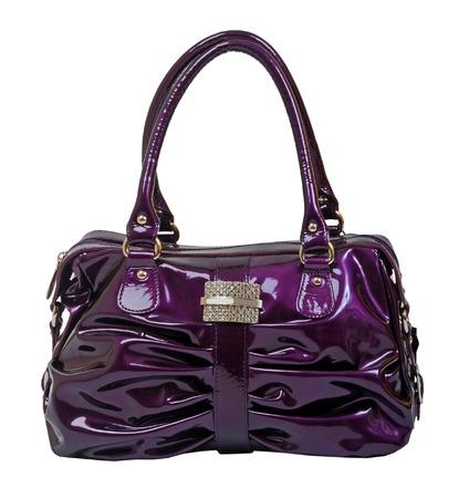 violet handbag isolted on white photo