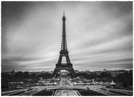 Dramatic Eiffel tower in France without people and cars around and empty streets of Paris. Postcard apocalyptic concept image of Black and white. Stockfoto