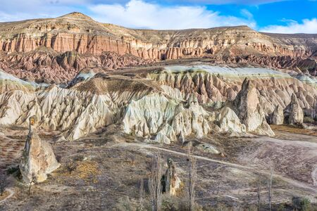 Rocky landscape of Rose valley with many colorful taxtures in a cloudy day with no people. Geological formations of Cappadocia.