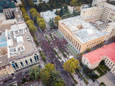 1 november, 2020. Tbilisi.Republic of Georgia. Post election protests in Tbilisi. Aerial view of crowds of people in front of parliament building.