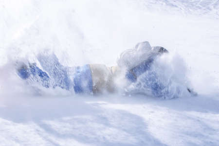 Male Person snowboarder close up fall on icy slope in fast motion