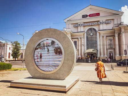 Vilnius, Lithuania - 1st july, 2021: Vilnius train station building with people in sunny summer day. Travel in Lithuania concept 版權商用圖片