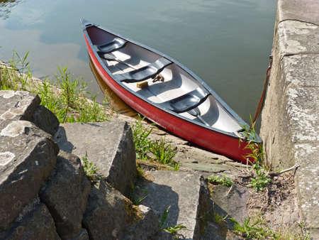 rhine westphalia:   Abandoned rowing boat on the river shore, Weser Stock Photo