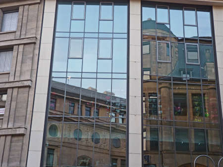 Houses reflected in a glass facade, Cologne