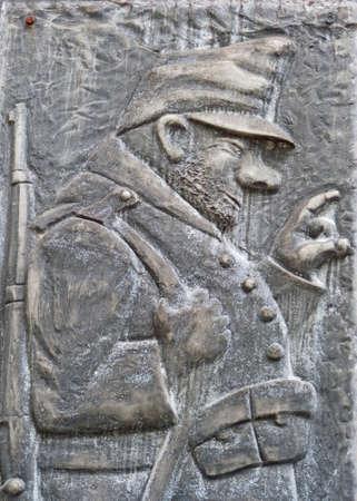 Hunter, sculpture on a wall