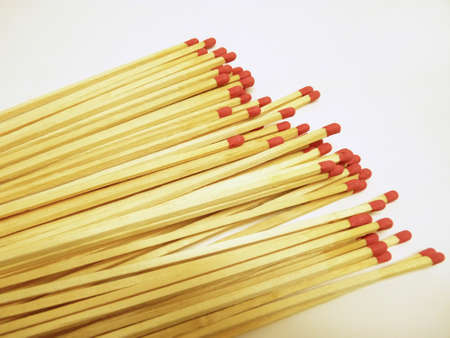 red head: Matchsticks with red head on white background Stock Photo