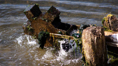 waterwheel: Small waterwheel in the river