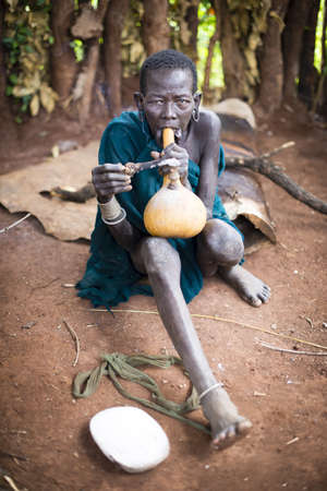 toxicology: Ethiopia, 9  November  2015, Surma tribe: Tribal women wit traditional pipe, traditional living in Ethiopia.
