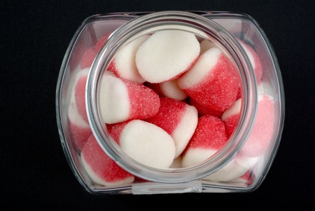 glass pot full of strawberry candies Stock Photo