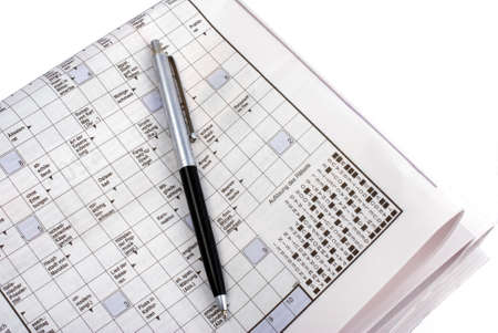 pen on a crosswod puzzle on newspaper Editorial