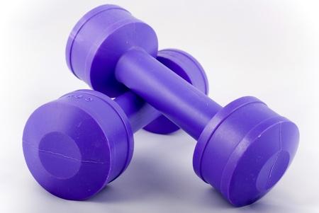 two purple dumbbells 2 kilo each Stock Photo
