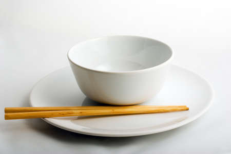 white porcelain plate   bowl with wooden chop-sticks