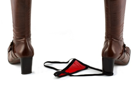 back fiew of brown leather high heel boots and red sheer sexy lingerie
