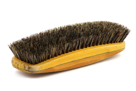 wooden clothes brush isolated on white