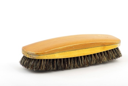 scrubbing up: wooden classic clothes brush isolated on white