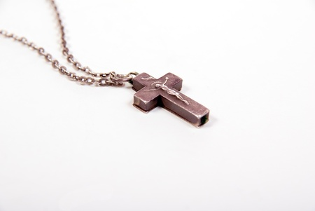 old silver necklace cross on white with copy space