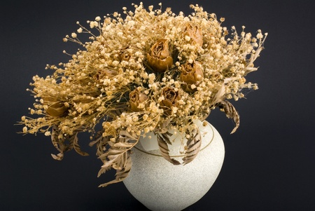bunch of dry flowers in a ceramic pot Stock Photo