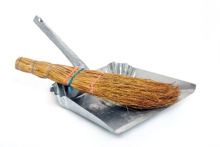 natural broom in metal dustpan on white background Stock Photo