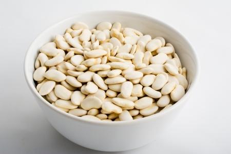 white porcelain bowl full of beans Stock Photo