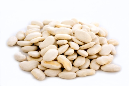 close up of white dry beans on light background
