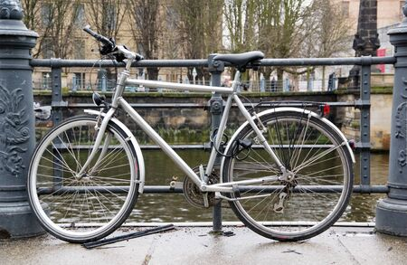 bicycle parked by riverside