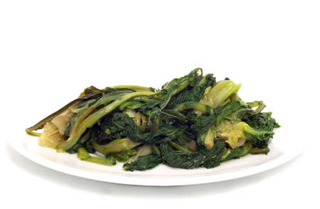 boiled green vegetables in white dish Stock Photo