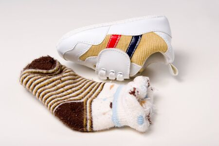 colorful baby shoe and sock Stock Photo