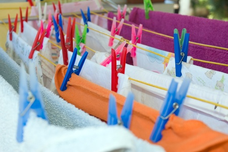 hanging clothes and colorfull plastic cloth pegs Stock Photo