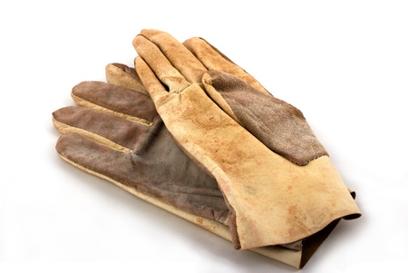 pair of brown leathen working gloves on white