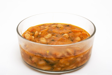 bean soup with carrots in glass bowl Stock Photo