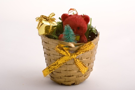 christmas basket decorated with toys, gifts and golden bow Stock Photo