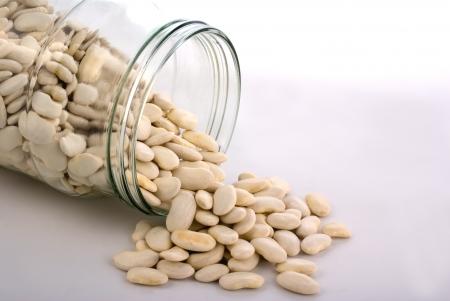 glass pot full of white beans Stock Photo