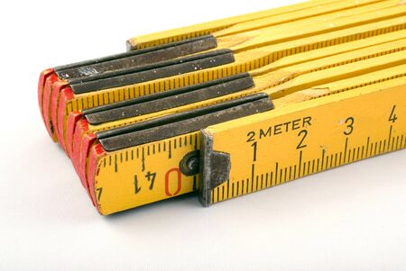 yellow wooden measure