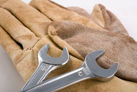 working gloves and wrench metal tools