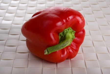 red pepper on bamboo place mat