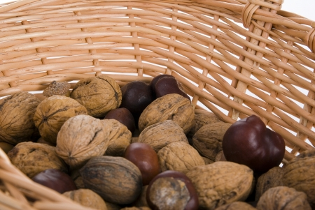 variety of nuts in a basket on white Stock Photo
