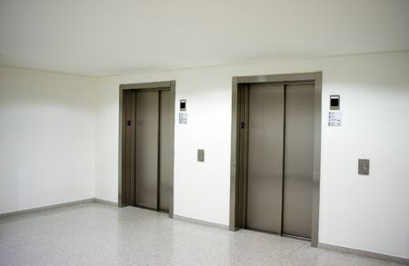 two publick elevators in hall lobby