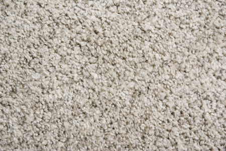 background of a fluffy beige interior carpet Stock Photo