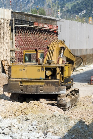 yellow earth moving buldozer machine in highway road and bridge construction Stock Photo