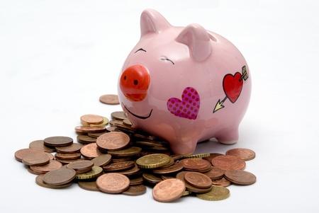 pink piggy money box on european cents coins