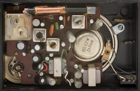 inside an old black pocket radio on white background