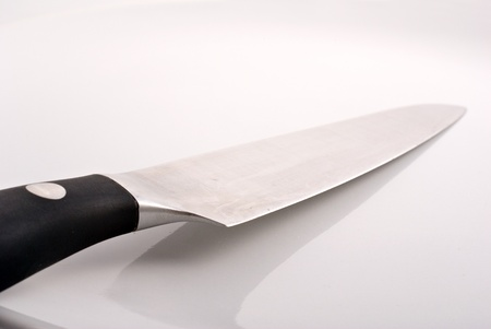 stainless steel kitchen knife in porcelain white plate Stock Photo