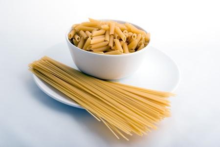 white porcelain plate   bowl full with pasta   macaroni Stock Photo