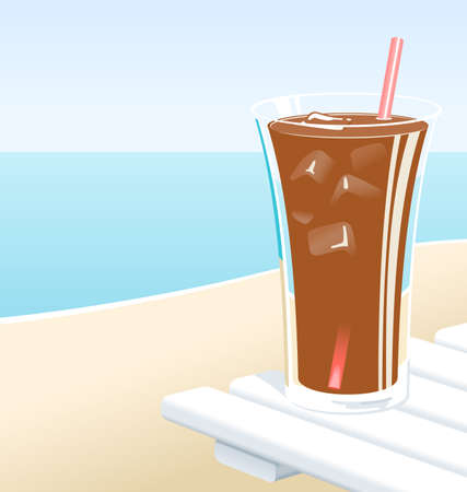 Cold glass of cola or iced tea with ice, at the beach in the Summer.