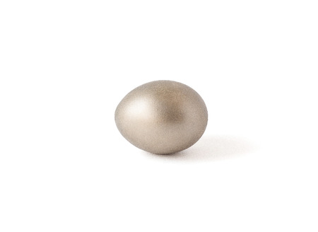 Egg of gold color are isolated on a white background. Gold. Handwork. Easter