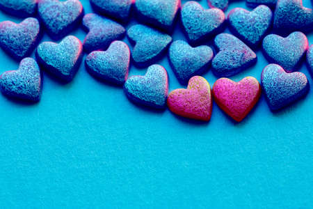 Blue and red Hearts Shape Candy on blue surface. Valentines Day concept. Copy space. Top view.
