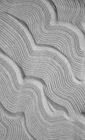 Abstract texture of gray sand. Pattern of sand waves as a background 스톡 콘텐츠