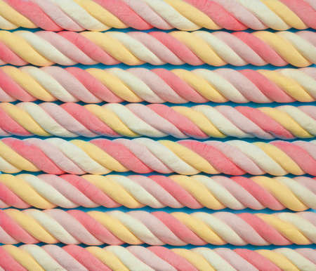 Marshmallow background. Sweet candy colorful texture. Rainbow colored marshmallow twists. 스톡 콘텐츠