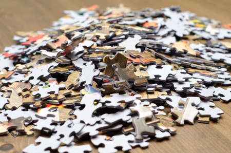 jigsaw piece: A pile of puzzle pieces marks the start of the next big project.